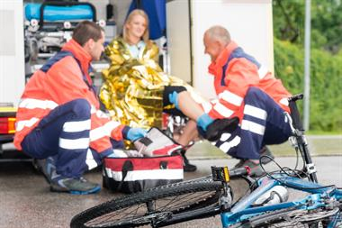 Paramedics helping bicycle accident victim
